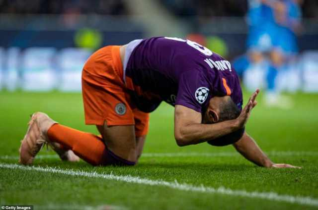 City's Gundogan appears to suffer a hamstring injury and is forced off the field midway through the second half