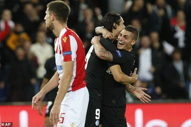 The Uruguayan striker is mobbed by Marco Verratti after putting the game beyond doubt