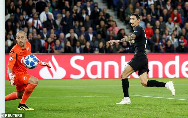 Angel di Maria flicks home PSG's fourth goal after a brilliant ball in by Thomas Meunier