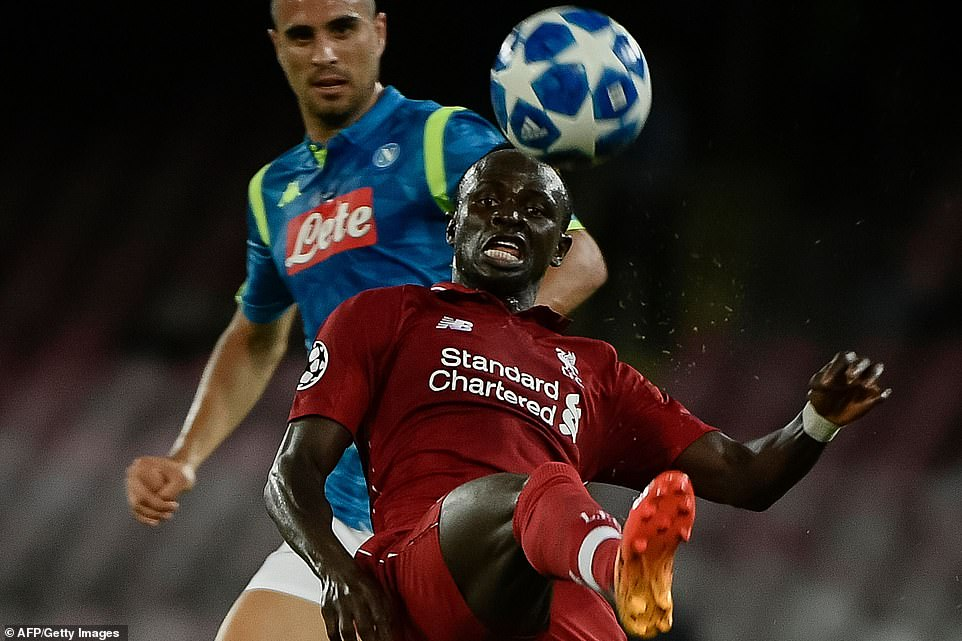 Liverpool's Senegalese forward Sadio Mane clears the ball during the UEFA Champions League Group C match against Napoli