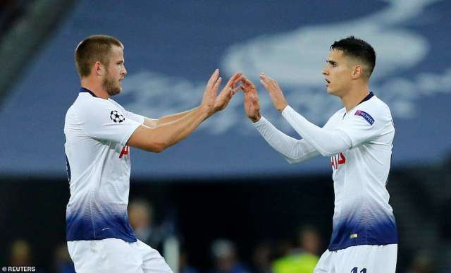 Lamela high-fives Eric Dier after scoring his goal but it proved to be nothing more than a consolation for Tottenham