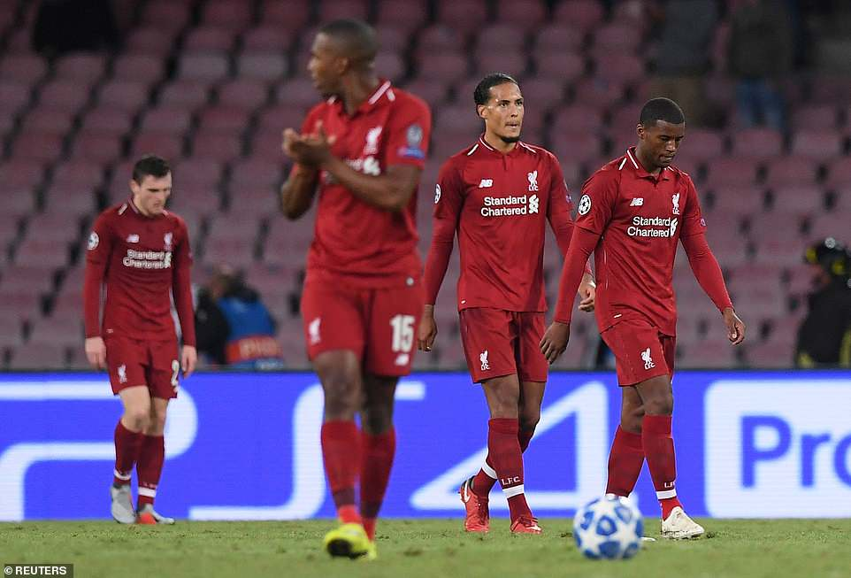 Liverpool players look dejected as they walk off the pitch having lost their Champions League Group C tie in Naples, Italy