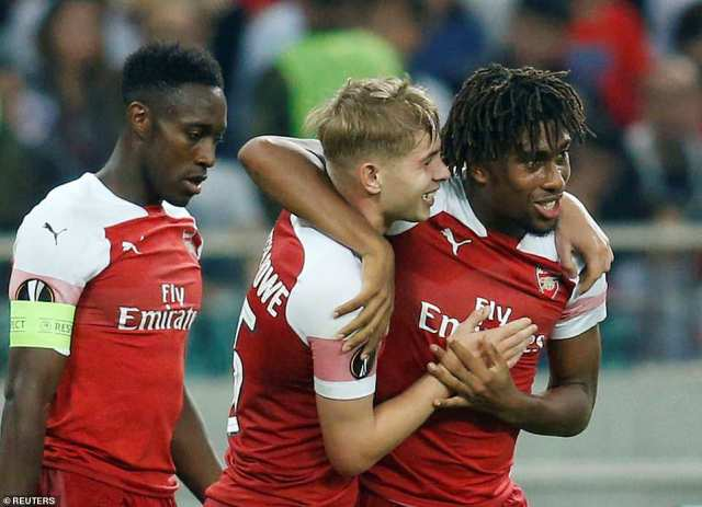 The 18-year-old midfielder is congratulated by Alex Iwobi, who played the ball on a plate to the highly talented youngster