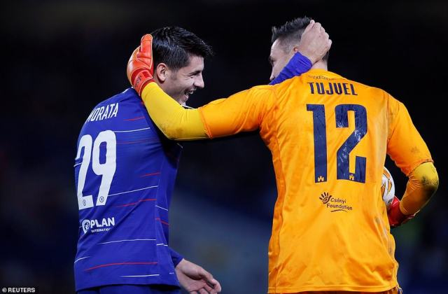 Morata and Tujvel see the funny side of the match in the first half of Thursday night's fixture as they both embrace