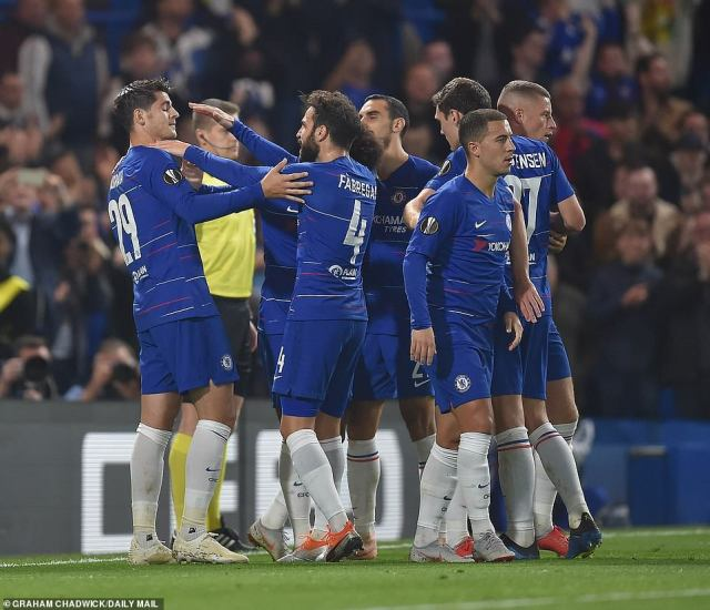 Morata's Chelsea team-mates raced to join him in celebration after scoring the goal that resulted in them winning the game