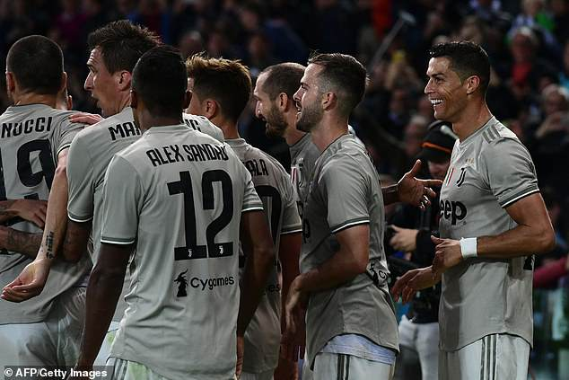 Ronaldo celebrates with team-mates during their 2-0 Serie A victory against Udinese