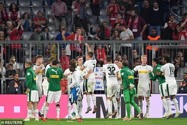 Borussia Monchengladbach players celebrate after beating Bayern Munich 3-0 on Saturday