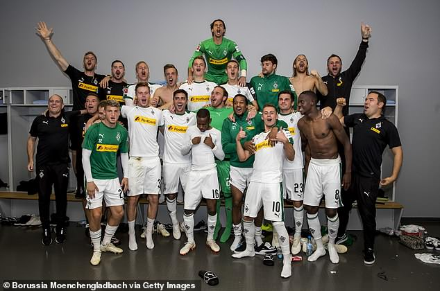 Borussia Moenchengladbach continue their celebrations in the dressing room at Allianz Arena