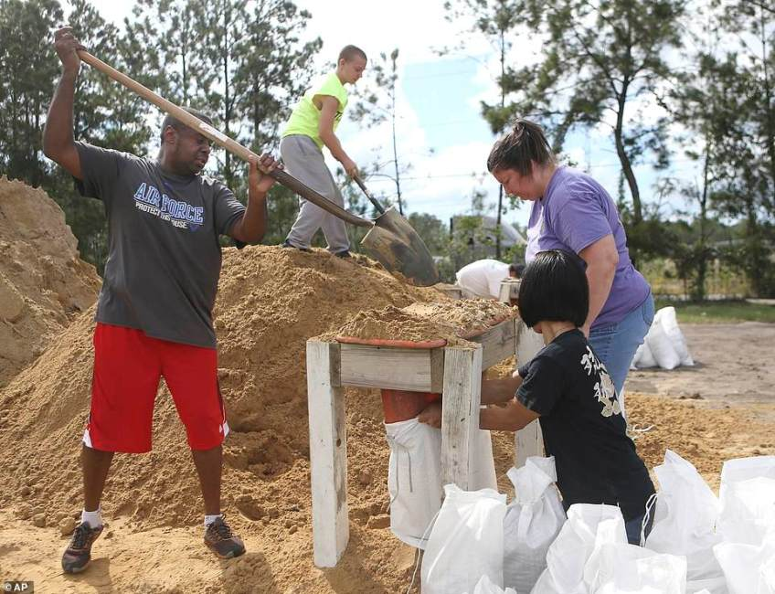 Residents of Lynn Haven, Florida fill sand bags at the Lynn Haven Sports Complex to prepare for Hurricane Michael on Monday