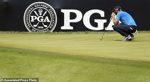 Dustin Johnson looks at his putt on the first green during the final round of the PGA Championship Golf Tournament at Bellerive Country Club, Sunday, August 12, 2018, in St. Louis. (AP Photo / Brynn Anderson)