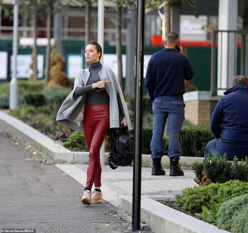 Solo outing: She kept things straight and serious while heading out in the midst of the shocking drama