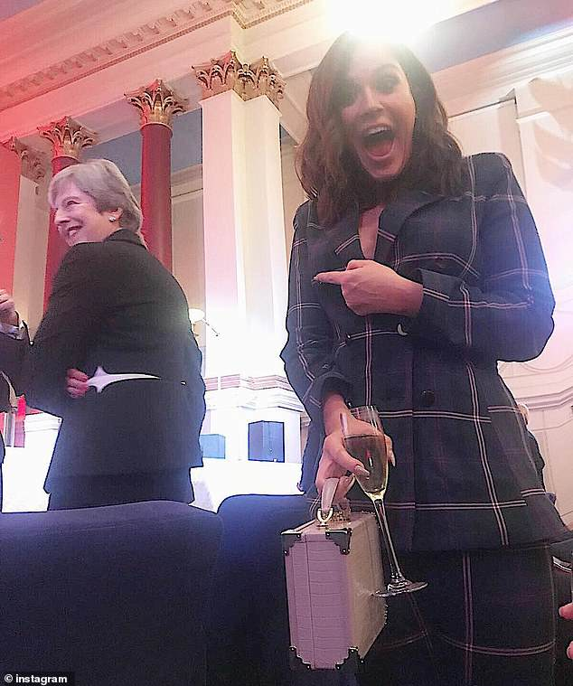 Fangirling: Vicky Pattison revealed she's a member of the Theresa May appreciation club on Tuesday as she snapped a sneaky selfie with the Prime Minister in the background