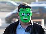Aaron Jones arrives at his court appearance over an alleged spray paint attack on a homeless man wearing aFrankenstein mask