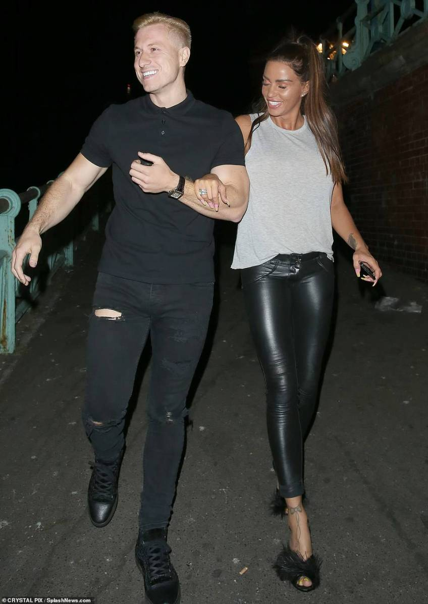 Shock: Katie Price 's appeared worse-for-wear as she turned up unannounced at ex-boyfriend Kris Boyson's 30th birthday party on Tuesday night, just hours before she was arrested on suspicion of drink-driving (pictured in July). She has since been released under investigation
