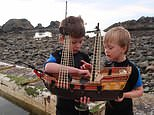 Ollie Ferguson, nine, and brother Harry, six, of Turriff, Aberdeenshire, have signed a book deal