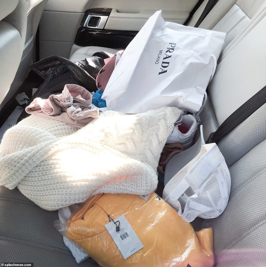 The interior of Katie Price's car is littered with various items of clothes, a baseball cap, a white shoe and a Prada bag