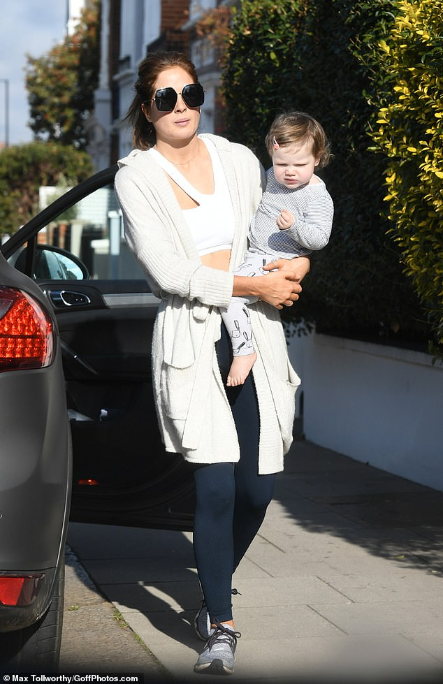 Hot:Drawing attention to her abs, the brunette beauty added a pair of skintight black leggings and grey Nike trainers