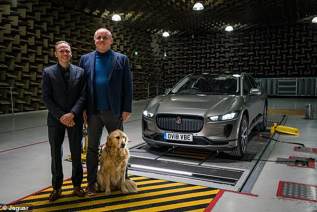 Jaguar technicianIain Suffield (left) with John Welsman from Guide Dogs for the Blind