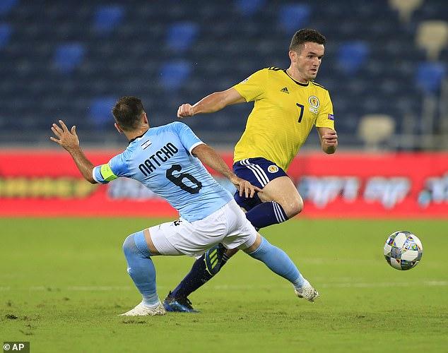 Aston Villa new boy John McGinn makes the early running in the heart of midfield for Scotland