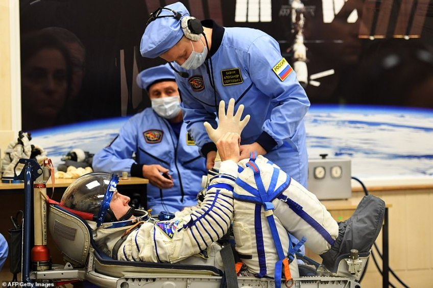 NASA astronaut Nick Hague testing his space suit with the help of NASA andRoscosmos technicians prior to the launch sequence on Thursday. Both Hague andOvchinin were inexperienced astronauts having graduated to their respective countries' space academies from careers in the US and Russian air forces