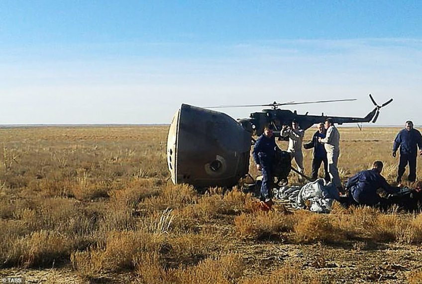 Rescuers pack up the parachute gear attached to theSoyuz MS-10 space capsule. According to NASA the emergency landing devices and parachutes worked perfectly and neither of the two men on board the capsule were said to have been injured after the incident