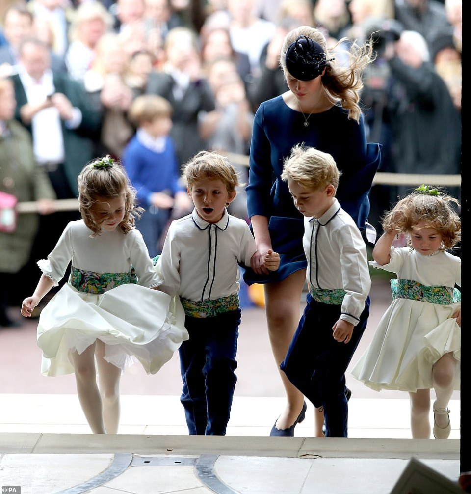 Lady Louise, the daughter of Prince Edward and the Countess of Wessex, took on an important role as she accompanied the young bridesmaids and page boys up the steps at St George's Chapel