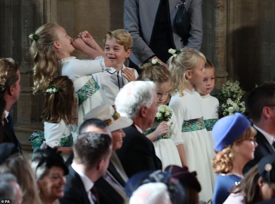 Cheeky Savannah Phillips kept Prince George entertained as they prepared to walk down the aisle with Princess Eugenie, seeming to imitate the trumpet fanfare that heralded the Queen's arrival