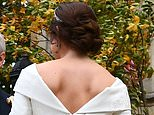 The scars from Princess Eugenie's back surgery were clearly on display after she chose a backless dress for her wedding today