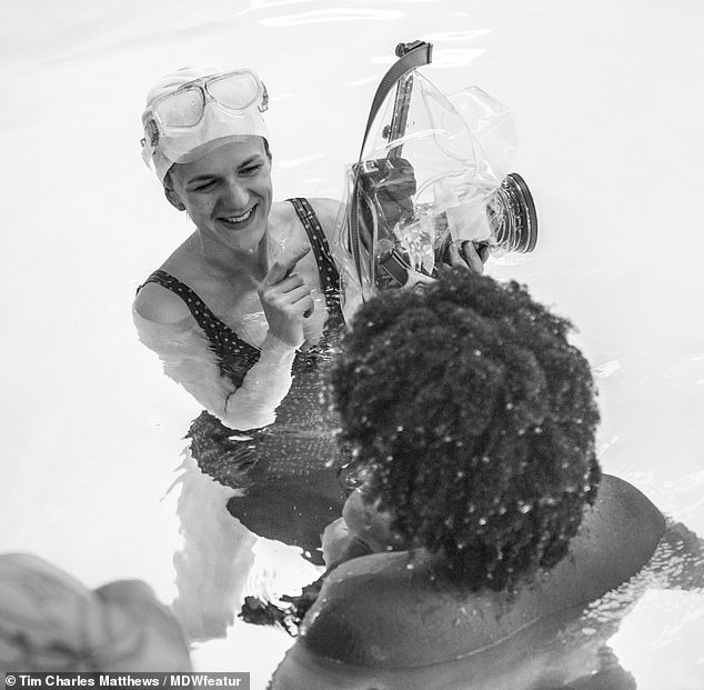 Behind the scenes: Ms Lennard is seen with one of her models in the swimming pool where the pictures were taken