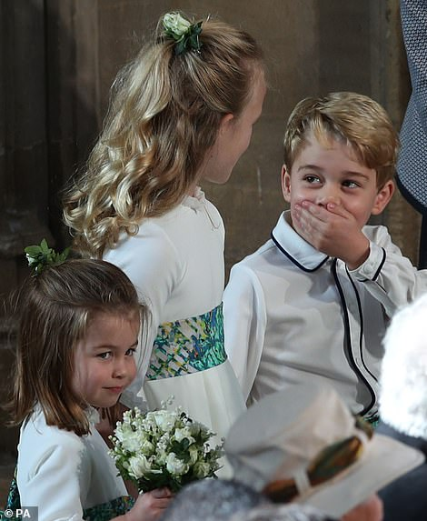Providing the entertainment! Seven-year-old Savannah Phillips seemed to be doing a good job of making Prince George laugh as they waited to walk down the aisle with Princess Eugenie