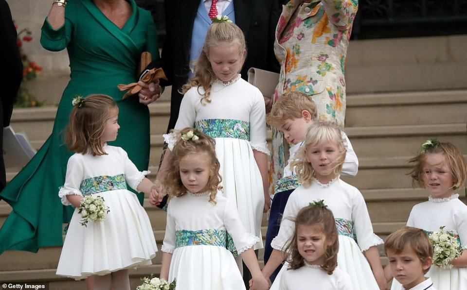 The bridesmaids and page boys making their way down the steps of St George's Chapel after the ceremony. Front: Theodora Williams and Louis de Givenchy. Centre left to right: Maud Windsor, Isla Phillips and Mia Tindall. Back left to right: Princess Charlotte, Savannah Phillips and Prince George