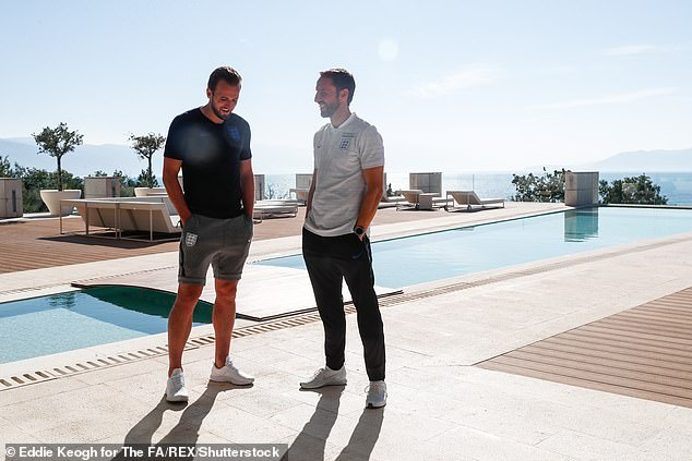 England manager Gareth Southgate chats with his captain, Harry Kane, ahead of the game