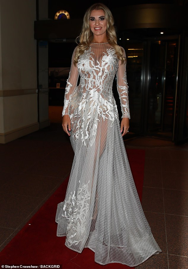 Wow: Paddy McGuinness' wife Christine ensured all eyes were on her as she arrived at the fashion bash wearing a dramatic sheer gown