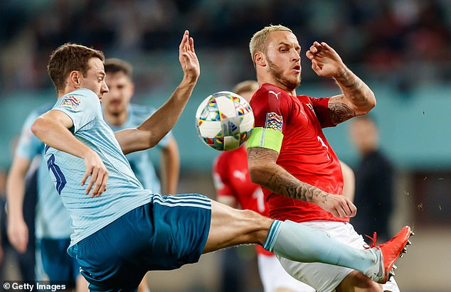 Evans was involved in a tough battle with Austria's Marko Arnautovic on Friday night