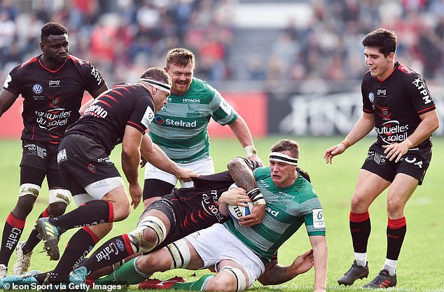 Glen Youngs is brought down by a Toulon player as Newcastle attack at the Stade Mayol