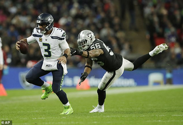 Wilson threw for three touchdowns and proved elusive for the Raiders defence in London