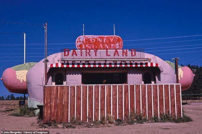 The Coney Island Dairy Land snack stand on Route 285 in Aspen Park, Colorado, appears to lie empty  in this 1980 photograph.Mr Margolies began photographing them in 1969 and so was able to save them for posterity when they began shutting down in huge numbers in the 1970s and 80s