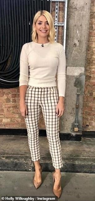 Dressed to impress: Holly's Anthropologie trousers picked up 110,000 likes one of which liked by John