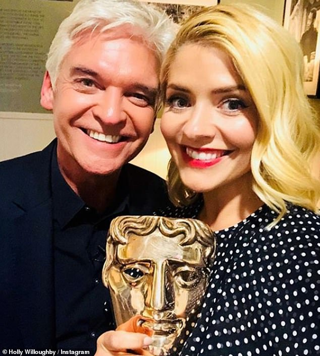 Celebrations: Understandably, Holly's snap with co-star Phillip Schofield when they picked up a BAFTA for This Morning was a popular one, getting 116,000 likes - and one from John