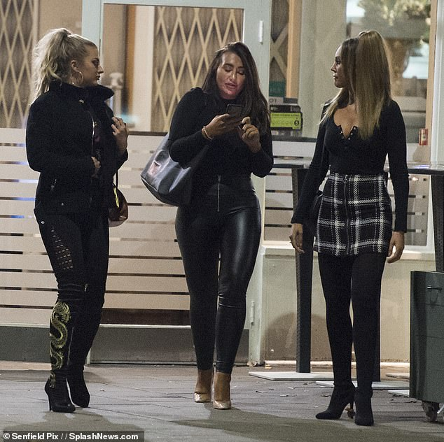 Looking good: The keen fitness enthusiast was dressed to impress in a pair of skintight leather trousers