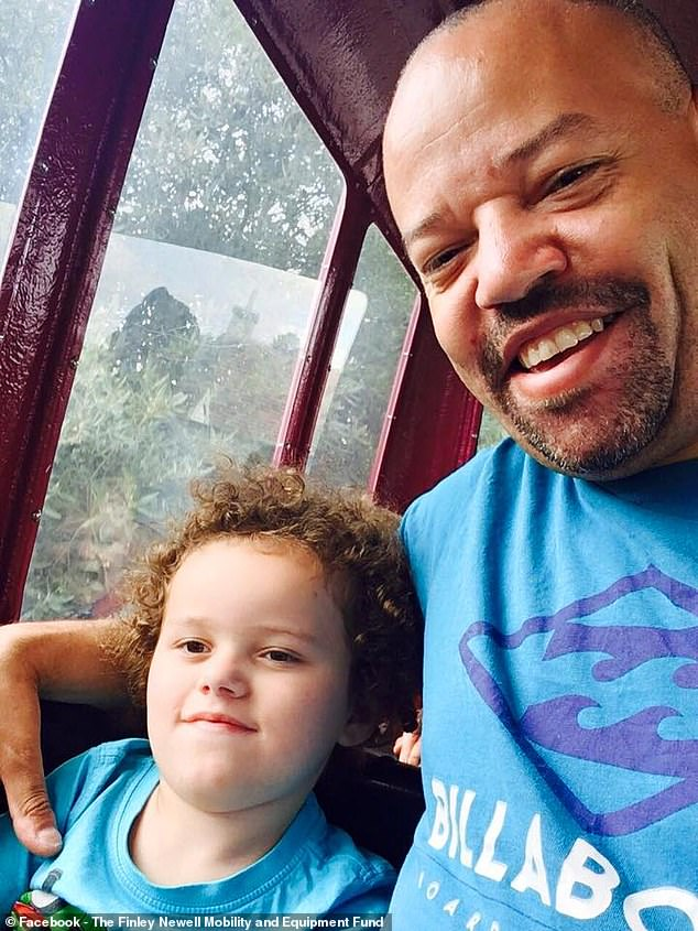 Finley (pictured with his father, Joel Newell, 45) has been in intensive care nine times since he was two because when he gets just a common cold his chest is too weak to cough up the mucous and his lungs fill up with fluid