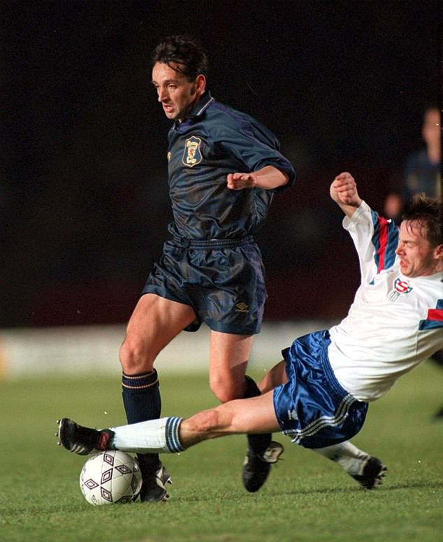 Nevin, pictured playing for Scotland, was an unusual character compared to his team-mates