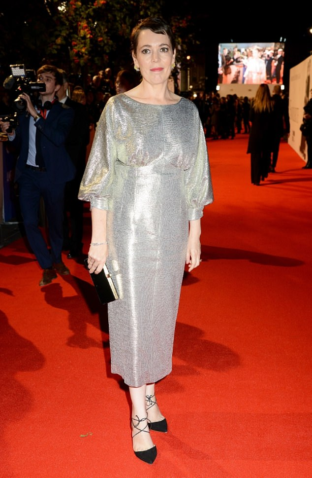 Shimmering star:The actress, 44, looked sensational in her silver gown which sparkled when she worked every angle under the heavy spotlight on the red carpet