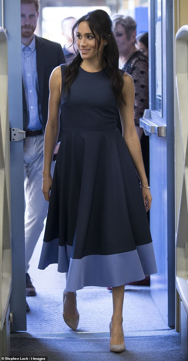Afternoon: The Duchess of Sussex sported a $2,376 (£1,295) two-tone blue midi dress by British label Roksanda for a visit to Macarthur Girls High School in Sydney