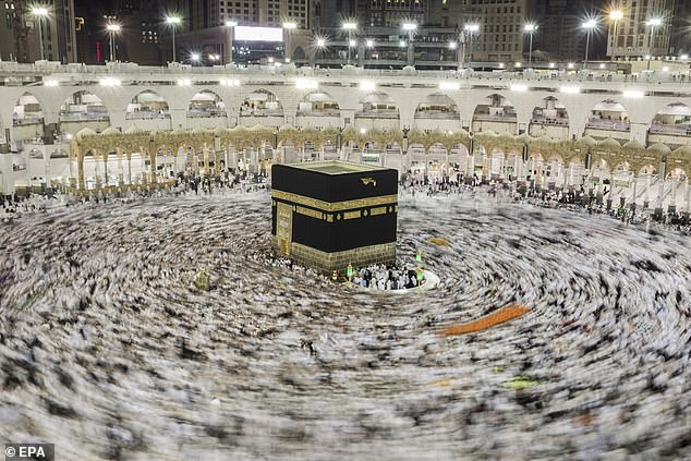Worshippers circle the Kaaba at Mecca which Muslims around the world point to in prayer