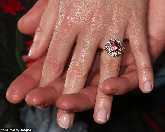 Beautiful: Princess Eugenie's ring also featured a colored gemstone in the center surrounded by diamonds