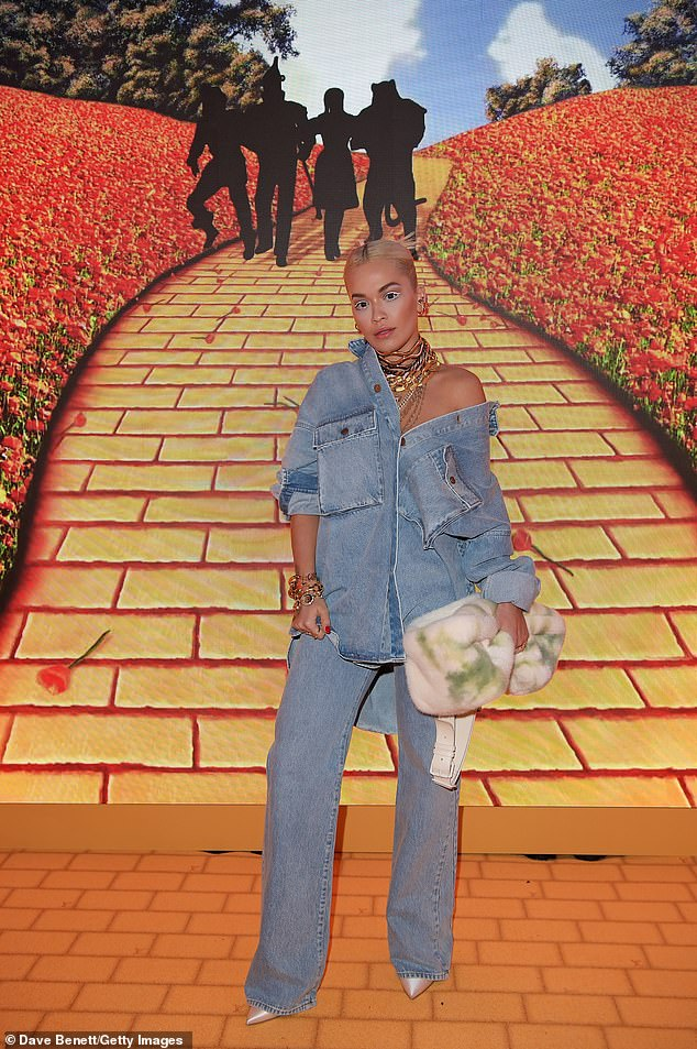 Take me home! Rita Ora showed off a lot of skin in her racy ensemble as she nailed double denim trend at star-studded Louis Vuitton event, in London on Friday
