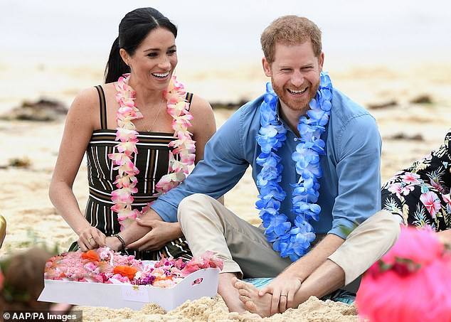 Loved up: Fiji's palmy beaches and friendly locals await Meghan and Harry (pictured above)