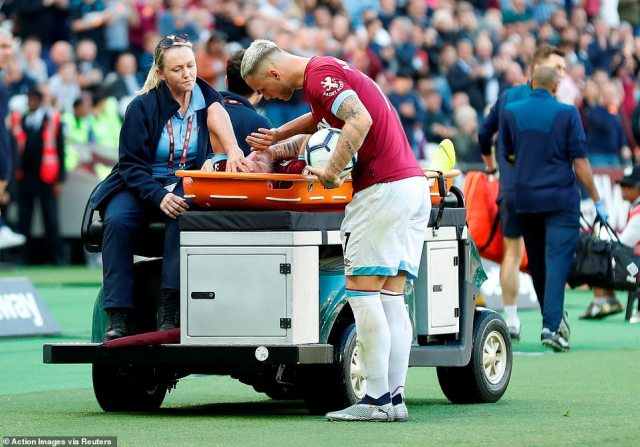 Arnautovic checks on his West Ham team-mate Yarmolenko after he is taken off the field on a medical cart