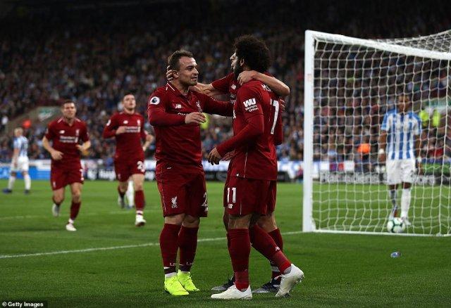 Salah celebrates with team-mate Adam Lallana (hidden) as well as Xherdan Shaqiri after breaking the deadlock in first half